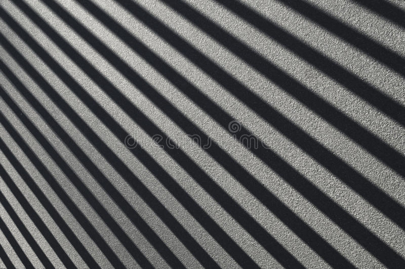 Shadows on asphalt. Parallel diagonal black and white shadow lines on asphalt royalty free stock images