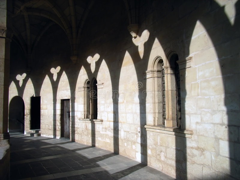 Shadows in the castle cloister - 2 royalty free stock images