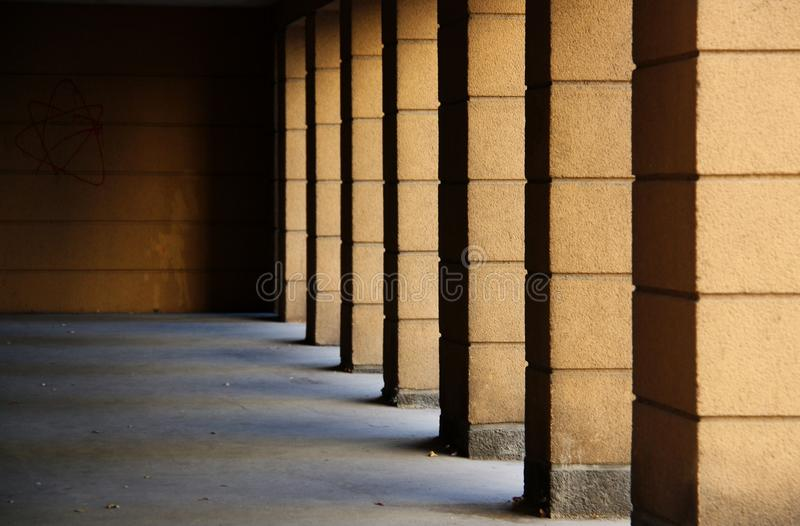 Shadows from the columns fall into the depths of the building stock image
