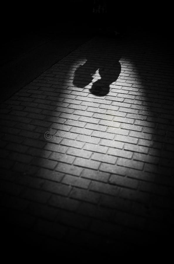 Shadows of couple in love on a walk in the city on sunny day. Man and women looking on each other, black and white photo stock photos