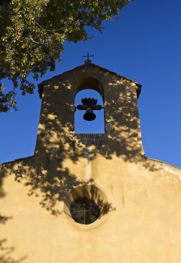 Shadows covering the Bell Tower, Chapelle Sainte Denis stock image