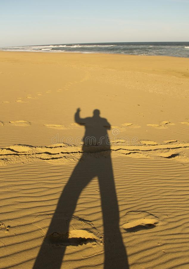 Shadow pf person on the beach stock images