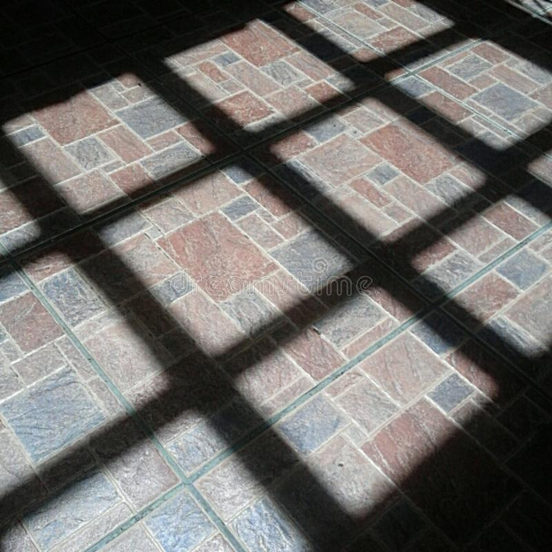 Shadows, lines and tiles stock photography
