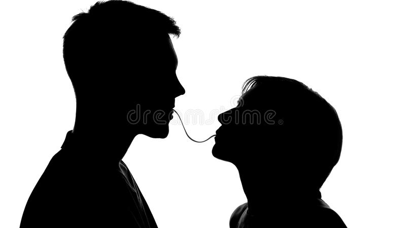 Shadows of lovers flirting and eating spaghetti on date, people cooking together. Stock photo royalty free stock photos