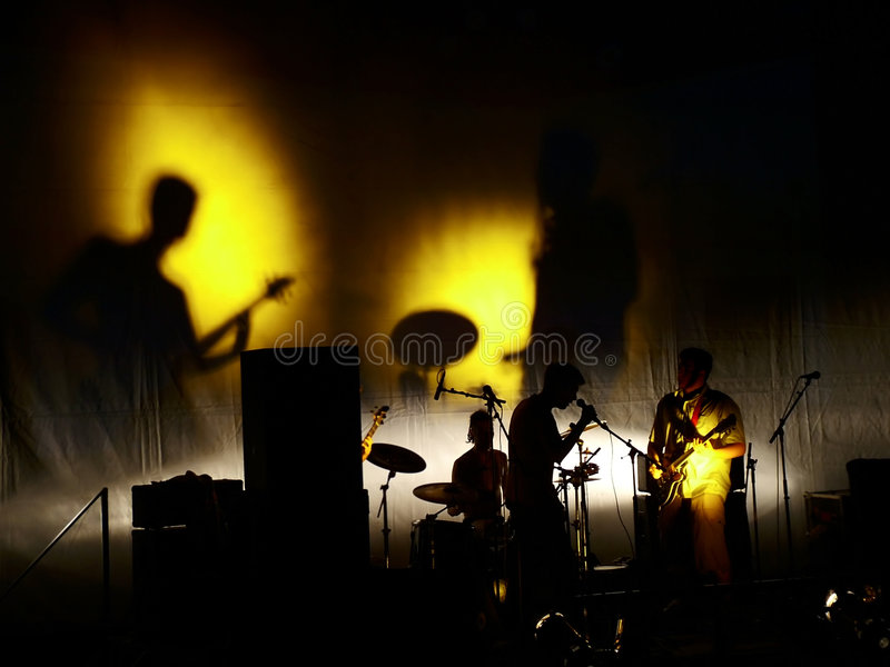 Shadows music concert. Rock music concert. Musician on concert. Musicians playing music