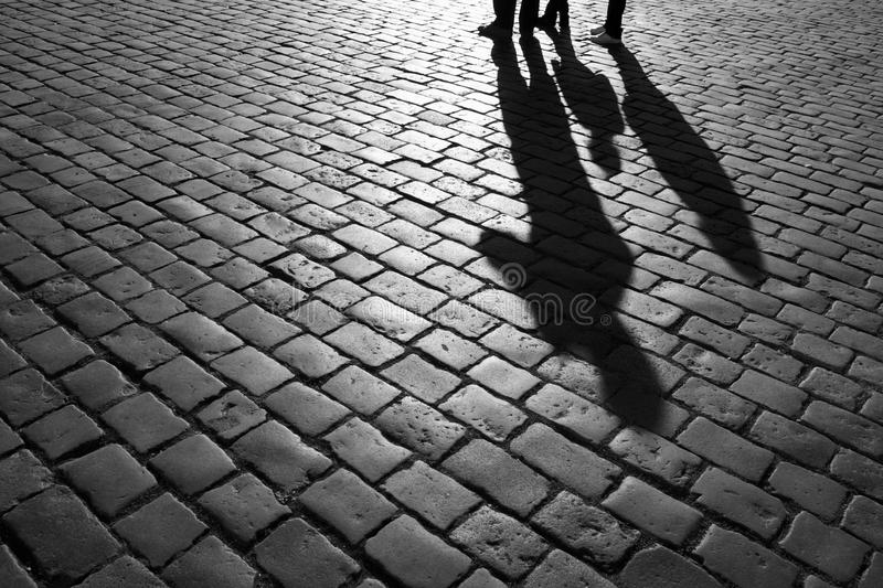 Shadows of people. Walking in a street of the city, Prague, September 2010 stock image