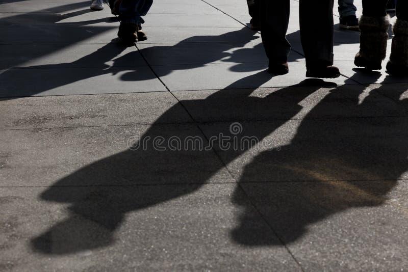 Shadows Of People Walking Stock Photo