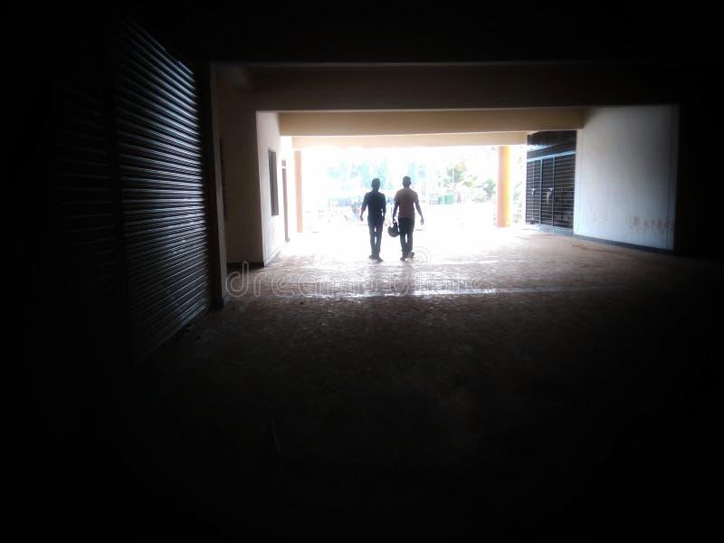two people walking stock photos