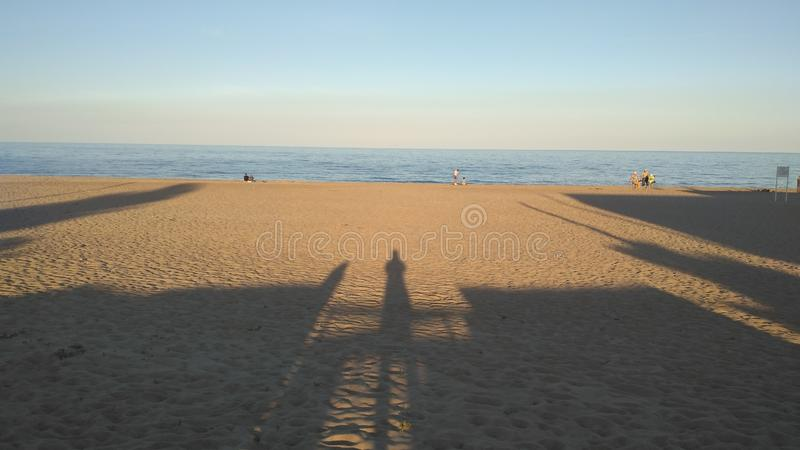 Shadows at sunset on the beach. Landscope, travel, sky, blue, water, sea, summer, outdoor, background, horizonbeautiful, holidey, sand, ocean, europe, outside royalty free stock photos
