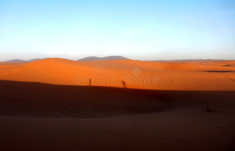 Shadows at sunset in the desert Sahara. The Sahara is the largest hot desert and the third largest desert in the world after Antarctica and the Arctic. Its area stock photography