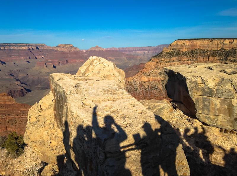Shadows of tourists on the boulders in the Grand canyon in the United States. Shadows of tourists on the boulders in the Grand canyon in the United States royalty free stock image