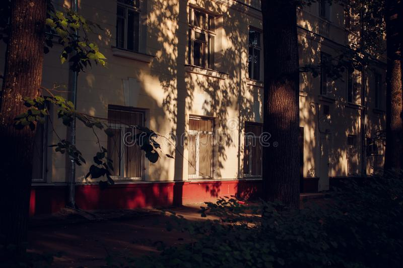 Shadows from trees on the facade of the house stock photos