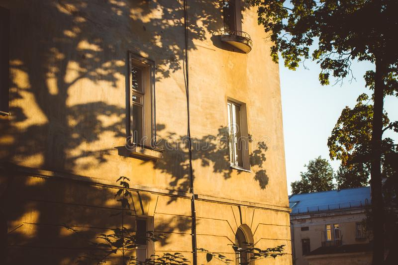 Shadows from trees on the facade of the house royalty free stock photography