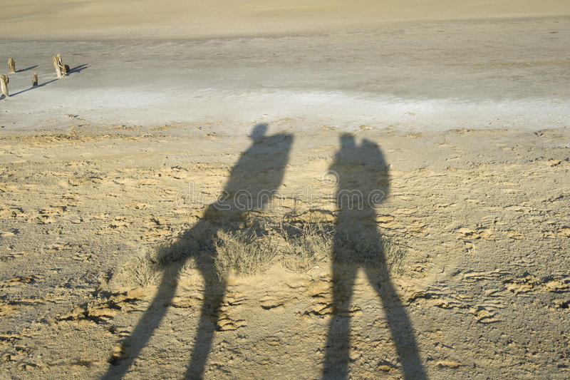 Download Shadows Of Two Travellers Stock Photo - Image: 23090820