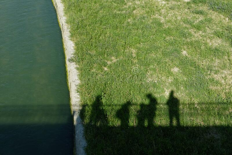 Shadows that walk on the riverbank royalty free stock images
