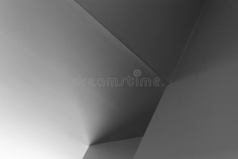 Shadows in white interior design. Abstract architecture background, white interior design with corners and soft shadows, black and white photo stock photography