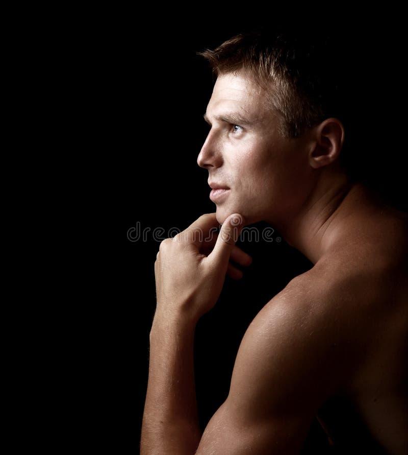 Shadowy dark close-up portrait stock photo