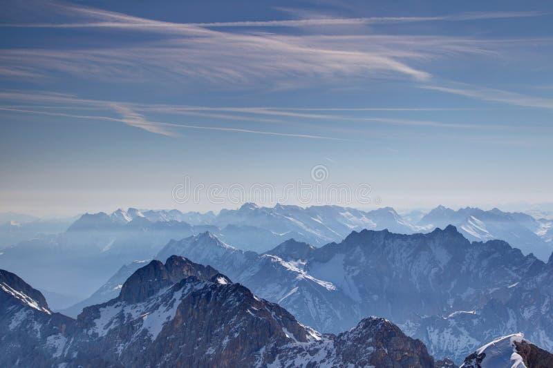 Shadowy and sunny ridges under blue sky Bavarian Alps Germany stock image