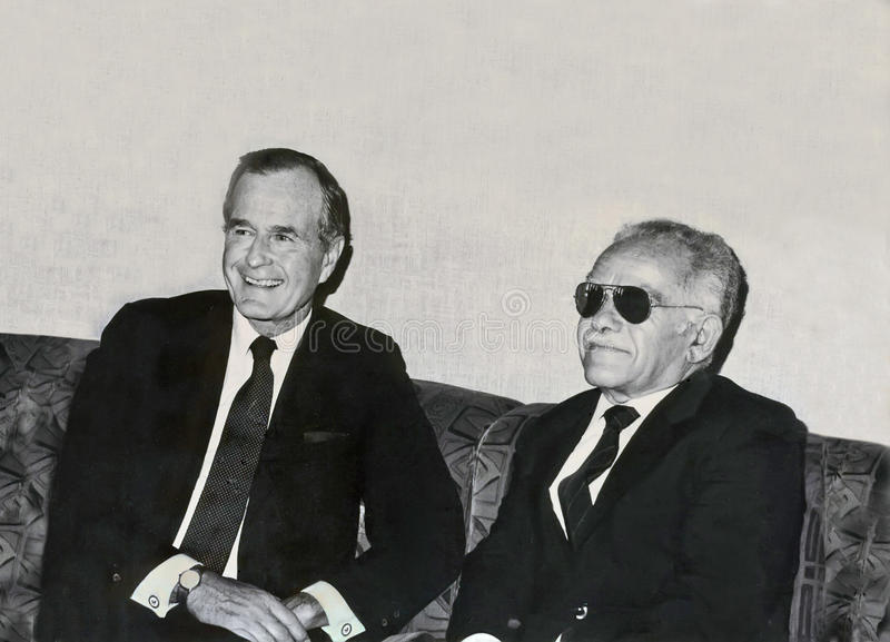 Shady diplomacy?. US Vice President George H.W. Bush meets with Israeli Foreign Minister and Deputy Prime Minister Yitzhak Shamir in Jerusalem on July 29, 1986 royalty free stock image