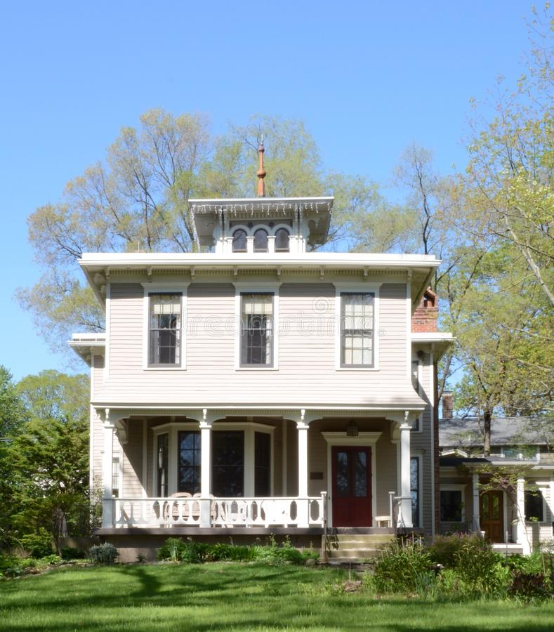 Shady Italianate. This is a Spring picture of a house in Geneva, Illinois. The house built in 1848 is an example of Italianate architecture. This picture was stock image