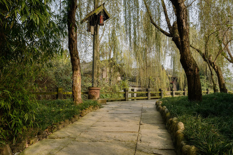 Shady riverside pavement in ancient town at sunny winter noon. Huanglongxi town,Chengdu,China stock photography