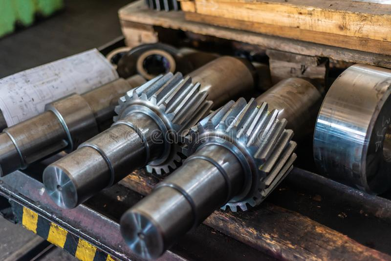 Shaft gear after milling are on the rack.  royalty free stock photos