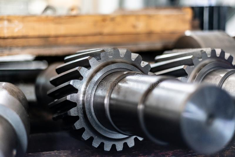 Shaft gear after milling are on the rack.  royalty free stock images