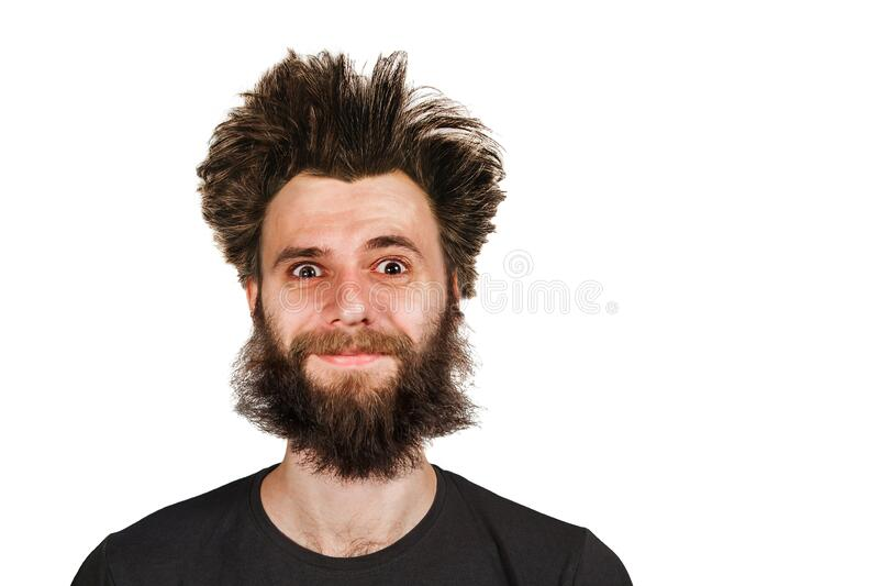 Shaggy young bearded man with long hair before haircut on a white isolated background.  royalty free stock image
