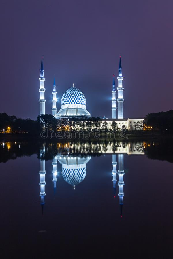 Shah alam, malaysia mosque during sunrise with reflection from the lake. Calm and beautiful view at shah alam, malaysia mosque during sunrise with reflection stock photography