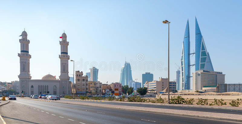Shaikh Hamad Causeway in Manama, Bahrain. Manama, Bahrain - November 21, 2014: Shaikh Hamad Causeway street view with mosque and The Bahrain World Trade Center royalty free stock photography