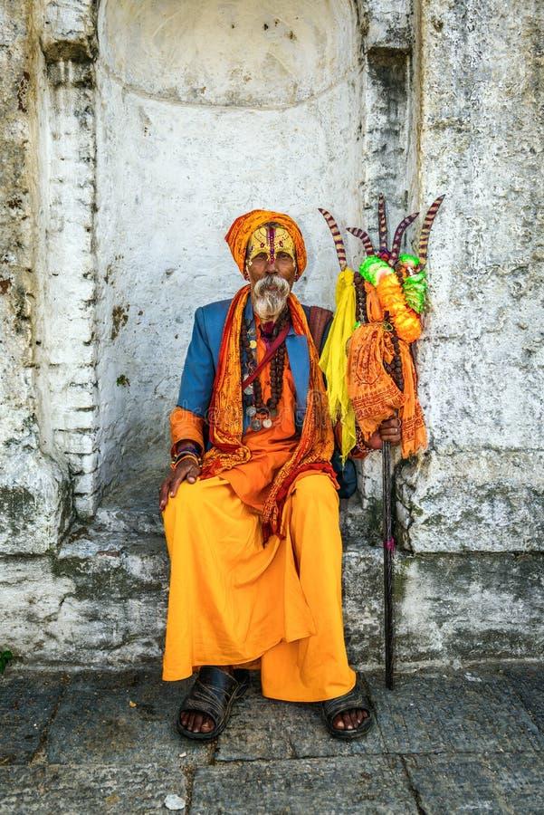 Shaiva sadhu (holy man) in ancient Pashupatinath Temple. KATHMANDU, NEPAL - OCTOBER 21, 2015 : Wandering Shaiva sadhu (holy man) with traditional face painting royalty free stock images