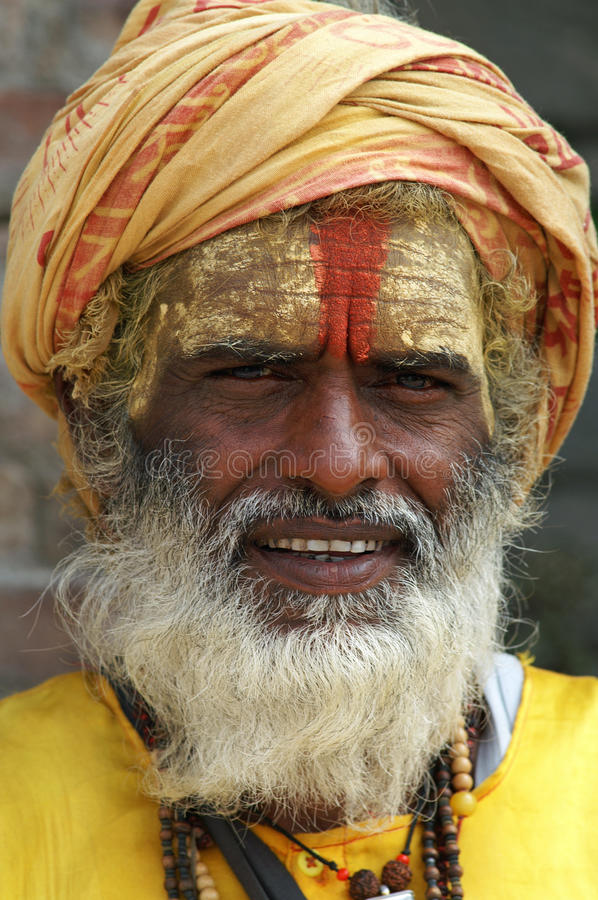 Shaiva sadhu (holy man) in front of a temple royalty free stock photo