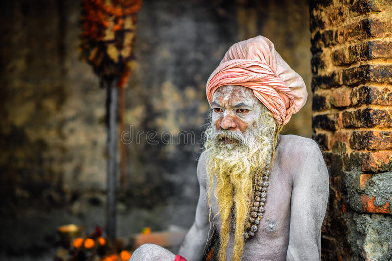 Shaiva sadhu (holy man) in Pashupatinath Temple, Kathmandu, Nep. KATHMANDU, NEPAL - OCTOBER 21, 2015 : Portrait of Shaiva sadhu (holy man) with traditional long royalty free stock photos
