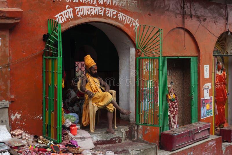 Shaiva sadhu seeking alms on the banks of Ganges river royalty free stock photos