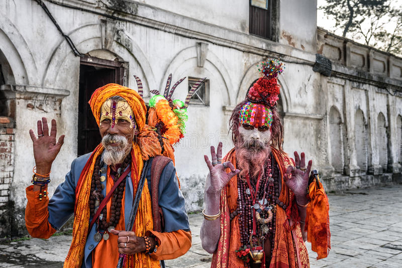 Shaiva sadhus (holy men) in ancient Pashupatinath Temple. KATHMANDU, NEPAL - OCTOBER 21, 2015 : Wandering Shaiva sadhus (holy men) with traditional body painting royalty free stock photo