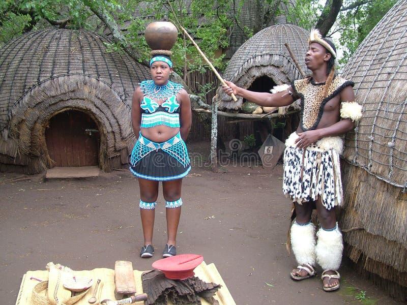SHAKALAND, SOUTH AFRICA - CIRCA NOVEMBER 2011: Unidentified Zulu woman balancing water pot on head royalty free stock images