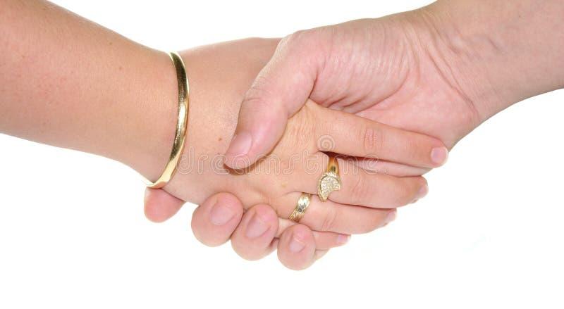 Shake hands. On white background stock photos