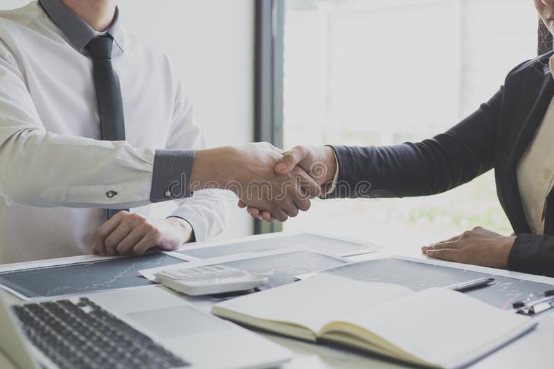 Shake hands of businessmen, young men, the company`s financial accountants join hands to congratulate the owners of successful. Companies that are very stock photo