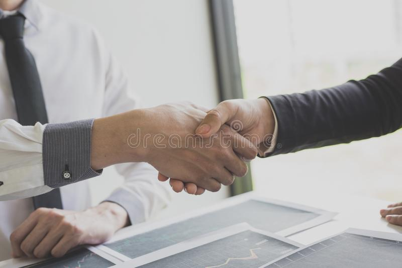 Shake hands of businessmen, young men, the company`s financial accountants join hands to congratulate the owners of successful. Companies that are very stock images