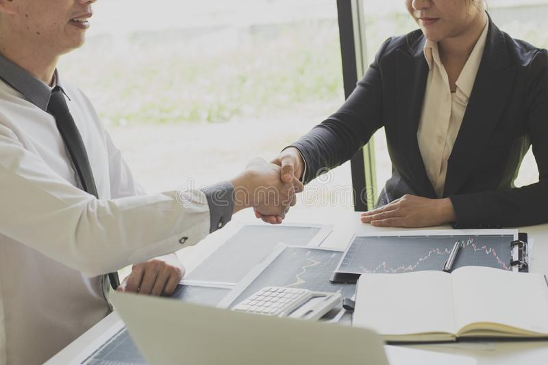 Shake hands of businessmen, young men, the company`s financial accountants join hands to congratulate the owners of successful. Companies that are very royalty free stock image