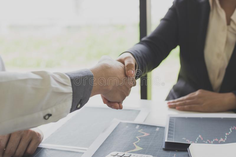 Shake hands of businessmen, young men, the company`s financial accountants join hands to congratulate the owners of successful. Companies that are very royalty free stock photos