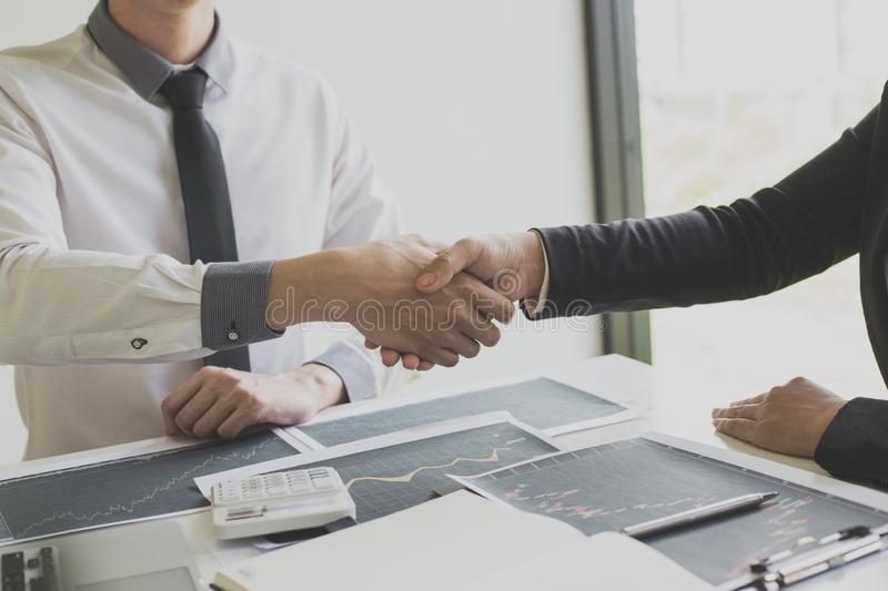 Shake hands of businessmen, young men, the company`s financial accountants join hands to congratulate the owners of successful. Companies that are very stock photography
