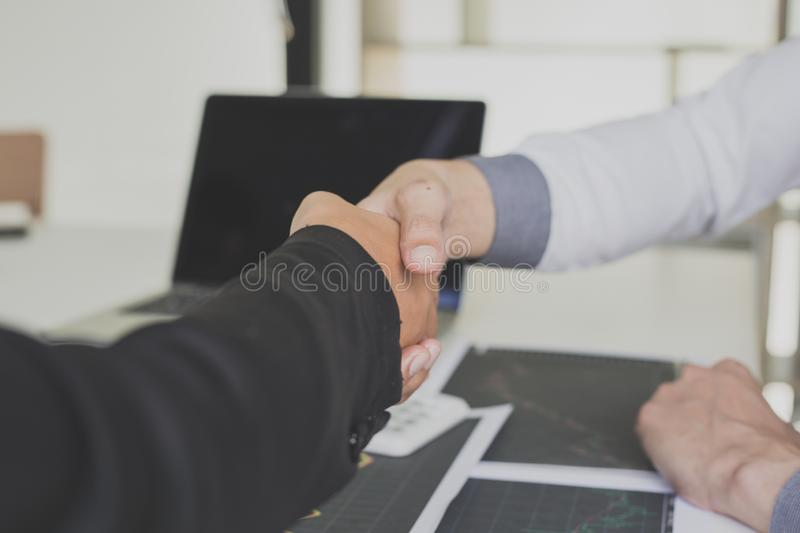 Shake hands of businessmen, young men, the company`s financial accountants join hands to congratulate the owners of successful. Companies that are very royalty free stock images