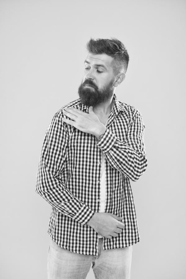 Shake it off. Summer hipster. Brutal bearded hipster in checkered shirt brush dust off shoulder. Male fashion. Pedantic. Man with beard on yellow backdrop stock images