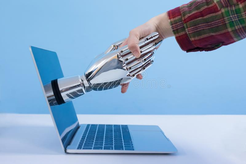 Shake with robot hand stock images