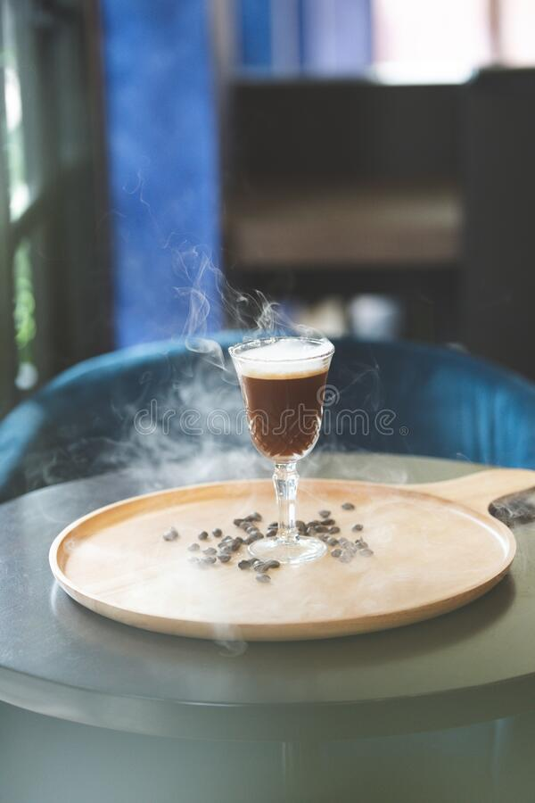 Shaken almond coffee with  a blast of rosemary. royalty free stock photo