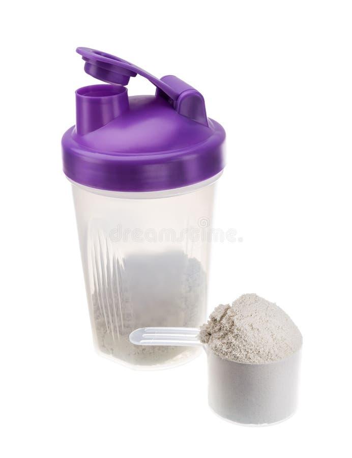 Shaker med protein för idrottsman nen Muskeltillväxt arkivfoto