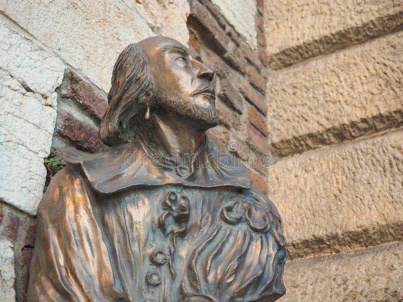 Shakespeare bronze bust in Verona. VERONA, ITALY - CIRCA MARCH 2019: William Shakespeare bronze bust statue in Verona, the city of Romeo and Juliet royalty free stock photos