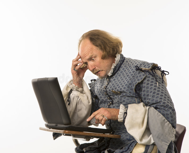 Shakespeare die laptop met behulp van. stock fotografie