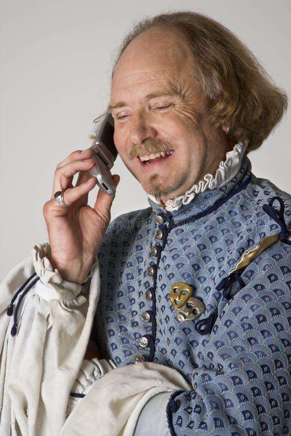 Shakespeare die op telefoon spreekt. stock afbeeldingen